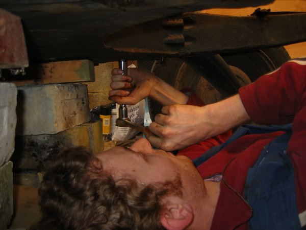 under the chassis undoing the bolts